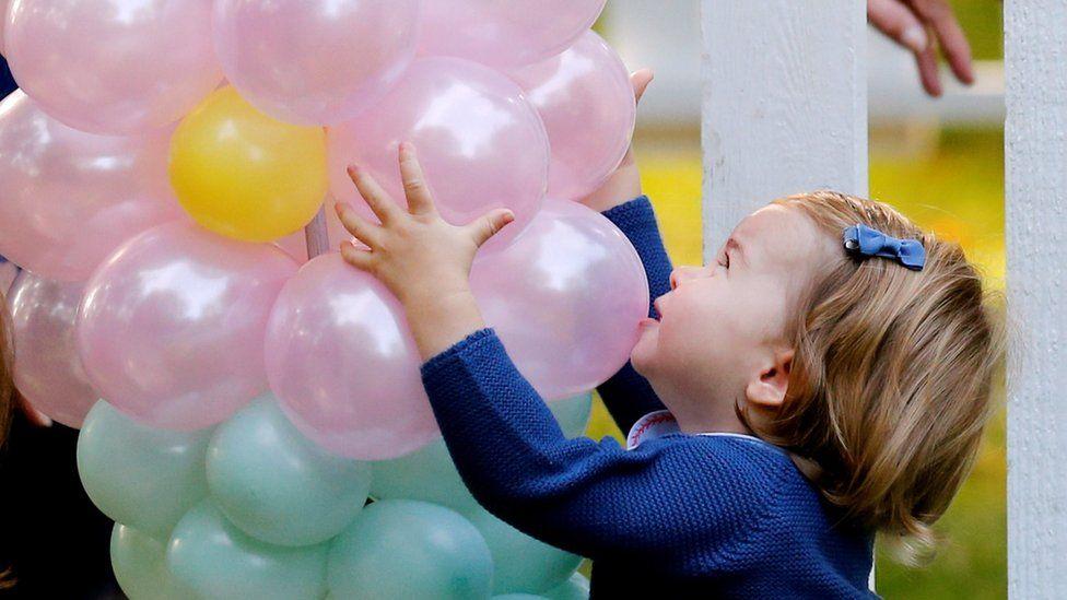 Princess Charlotte grabbing balloons