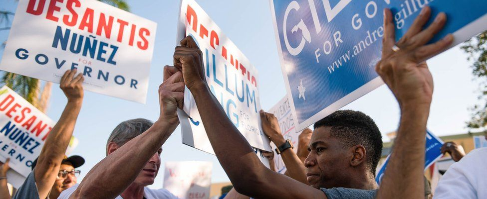 Supporters of the Republican and Democratic candidate for Florida governor face off