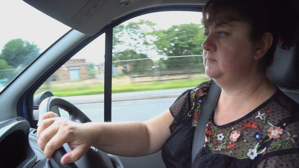 Christine driving van.