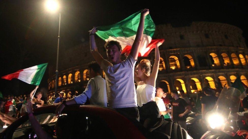 Italian fans outside Rome's Colosseum