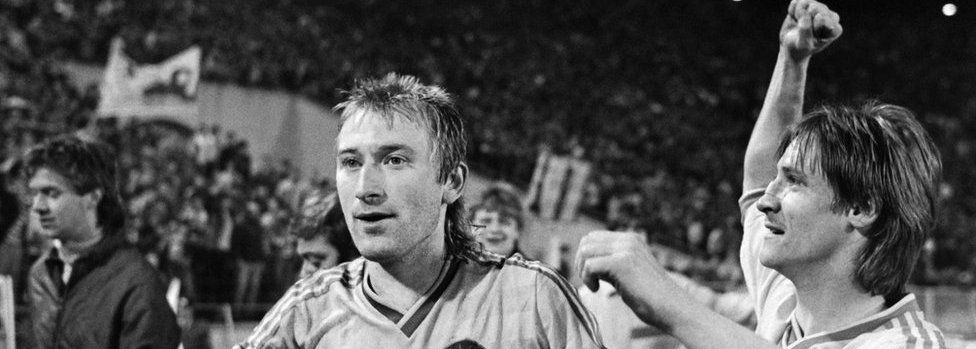 Leipzig's Matthias Liebers (L) and Ronald Kreer (R) celebrate their victory at the end of the semi final between Bordeaux and Lokomotiv Leipzig, on April 22, 1987, in Leipzig