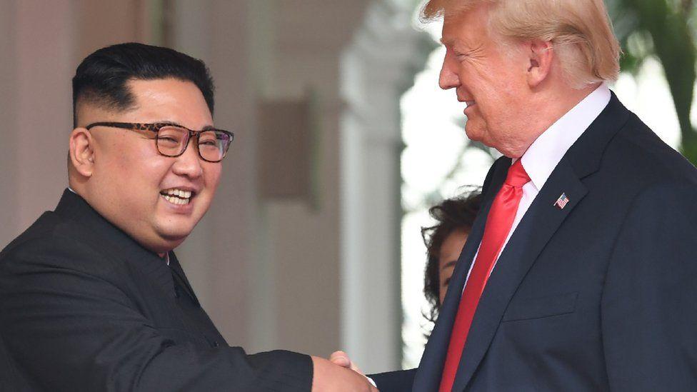 Kim Jong-un and Donald Trump shake hands in Singapore