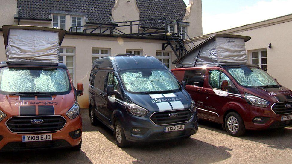 Staff are sharing three campervans