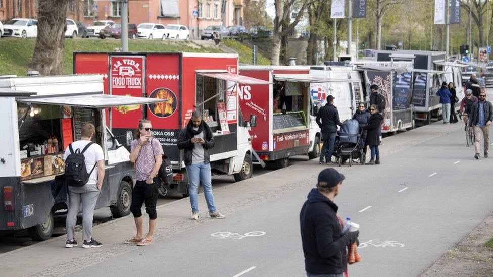 People buying from food trucks in Stockholm, April 2020