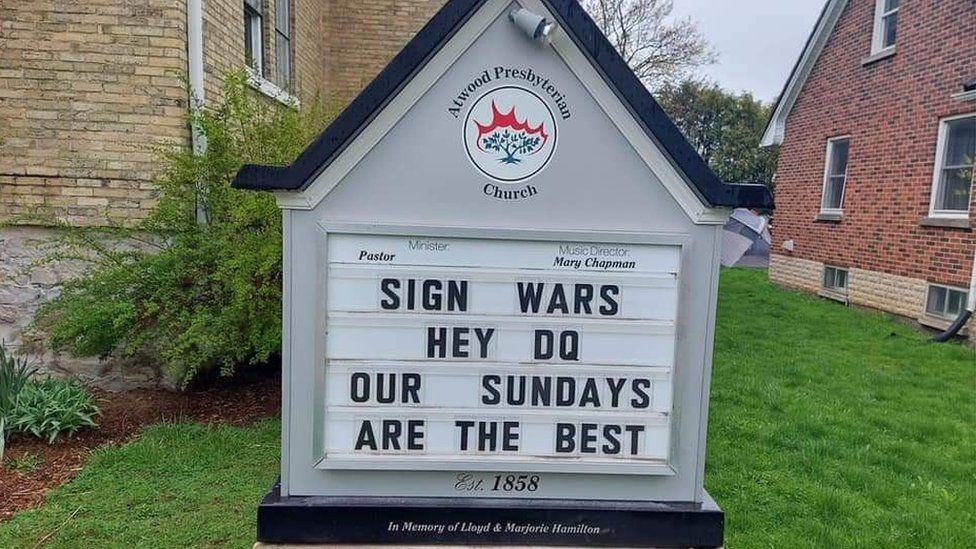 A sign at a church reads 'Hey DQ, our Sundays are the best'