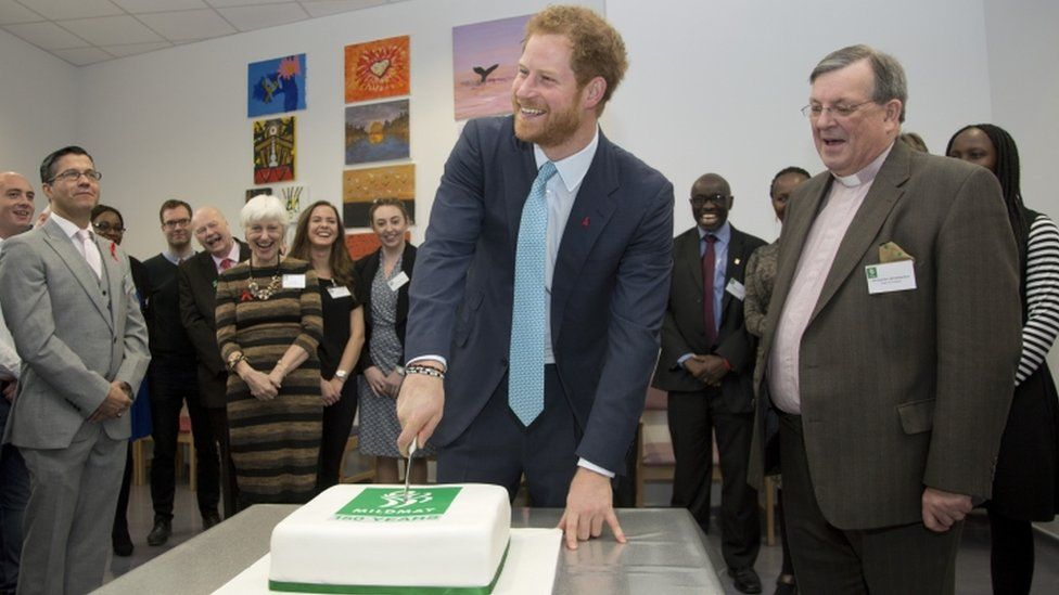 Prince Harry cuts a cake to celebrate the hospitals 150th year next year