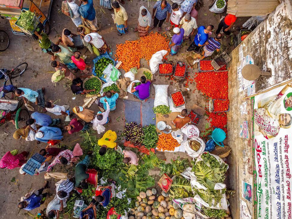 An aerial view of people shopping at a vegetable market, Barishal, Bangladesh (13 April)
