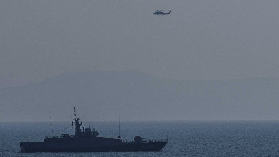 Turkish warship and helicopter patrol Aegean sea between Turkish coast and Lesbos island. 21 March 2016