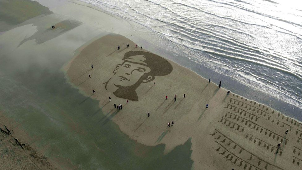 A portrait of John McCance, a soldier from County Down who died at Passchendaele, is drawn in the sand at Murlough Beach
