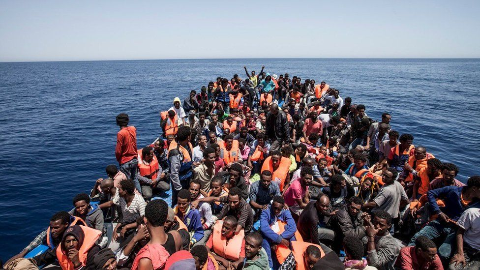 Migrants crowd the deck of their wooden boat off the coast of Libya on 14 May 2015.