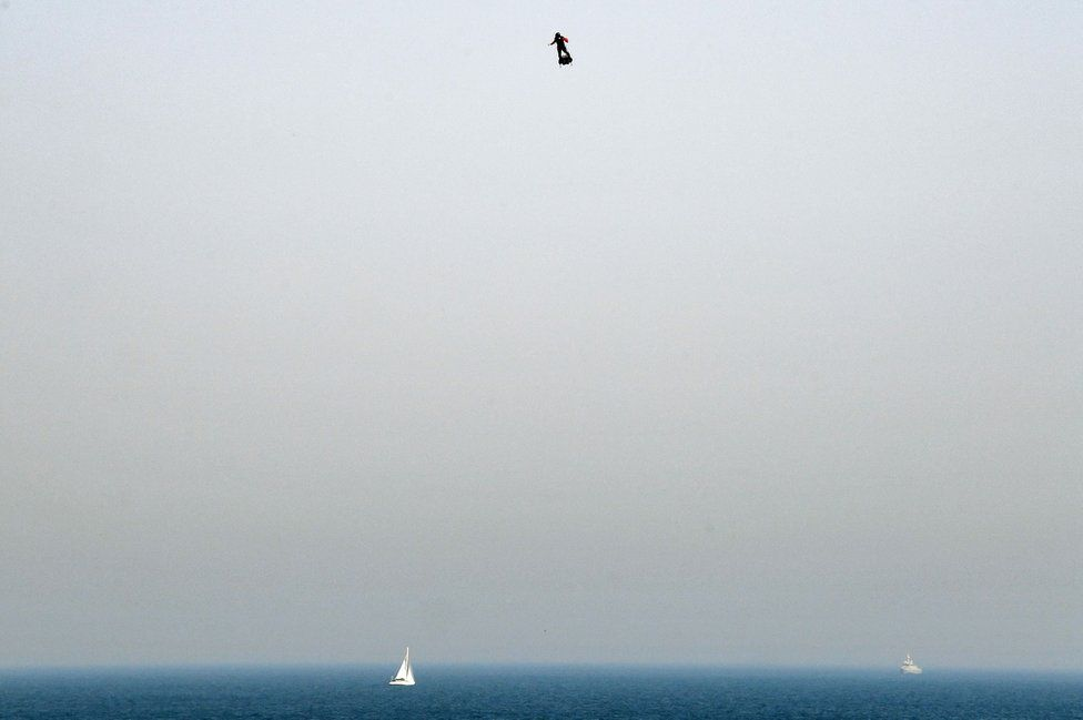 Franky Zapata stands on his jet-powered flyboard as he takes off from Sangatte, northern France