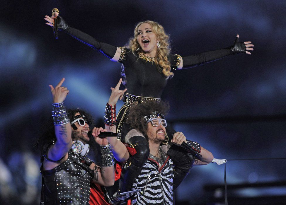 Singer Madonna performs with Redfoo and Sky Blu of LMFAO during the NFL Super Bowl XLVI game halftime show on February 5, 2012 at Lucas Oil Stadium in Indianapolis, Indiana