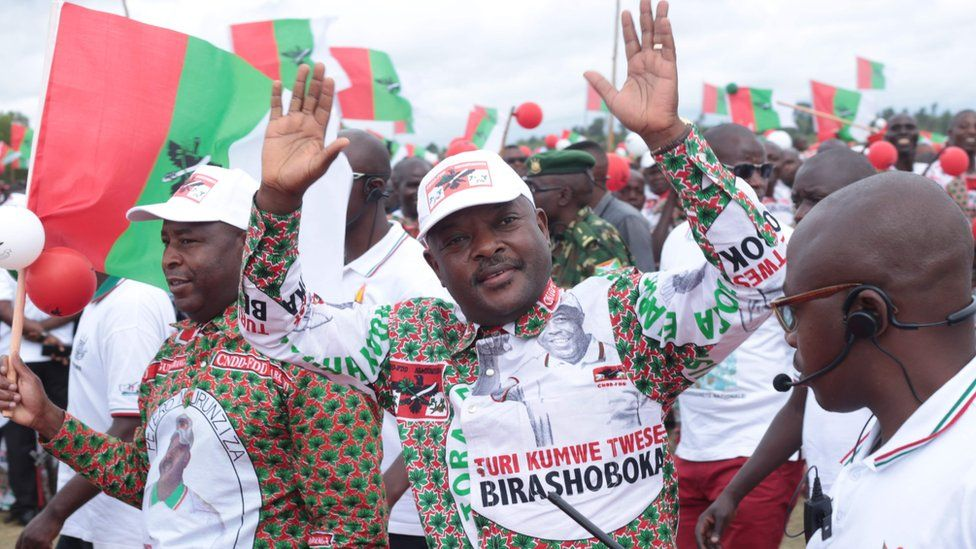 Burundis incumbent president Pierre Nkurunziza (C) reacts to supporters as he arrives to the opening of the campaign of the ruling party