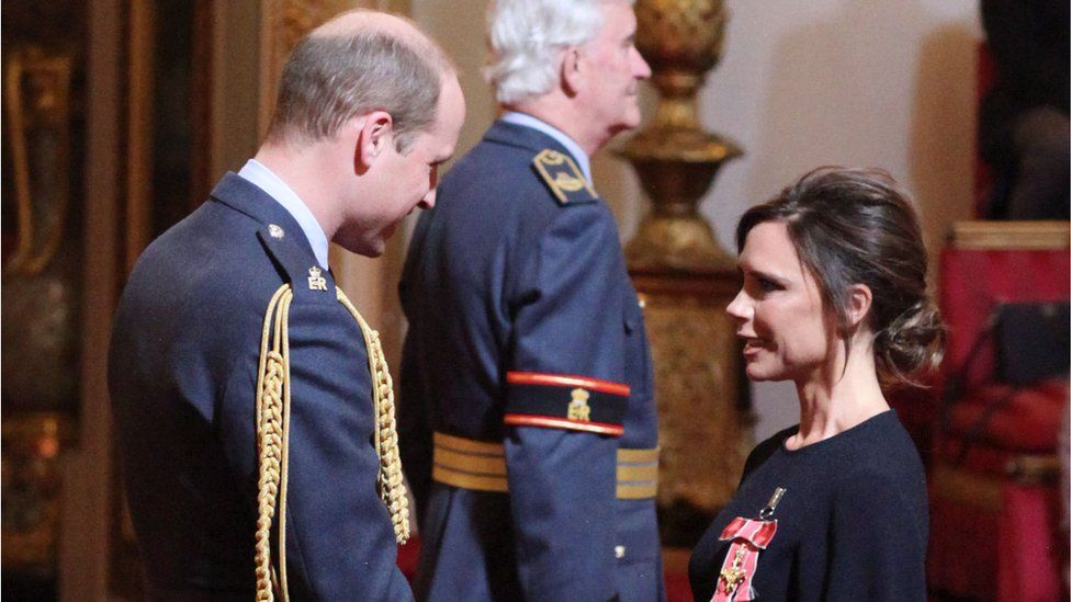 Victoria Beckham receives her OBE from Prince William