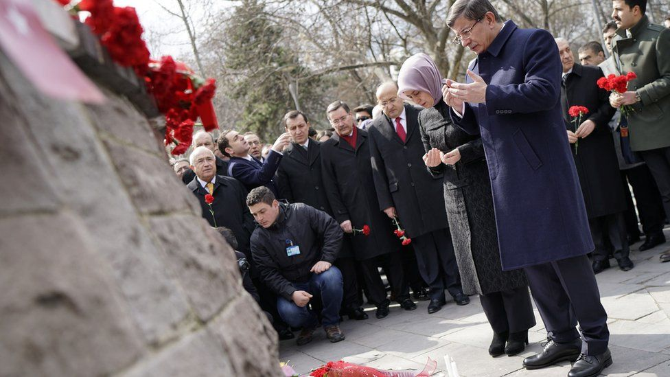 Turkish Prime Minister Ahmet Davutoglu and his wife Sare pray at scene of attack in Ankara. 17 March 2016