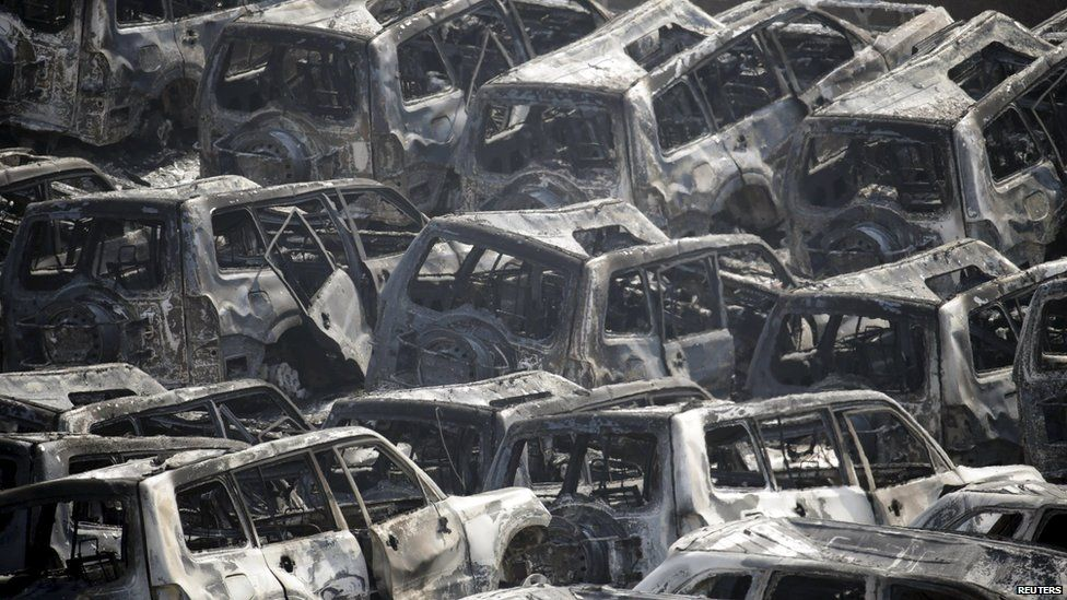 Burnt out cars in the aftermath of explosions at Tianjin