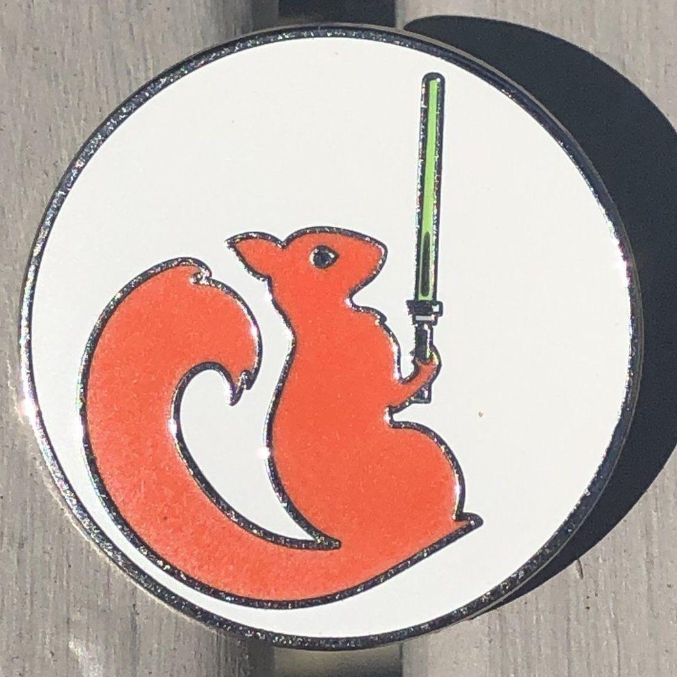 Emblem of squirrel with lightsaber