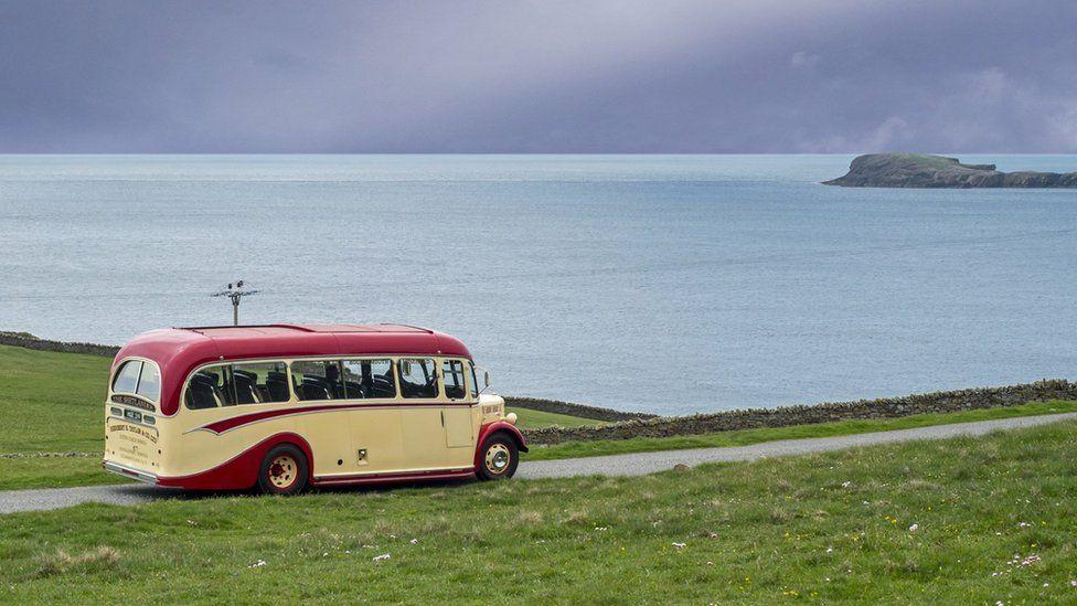 Coach on a coastal road