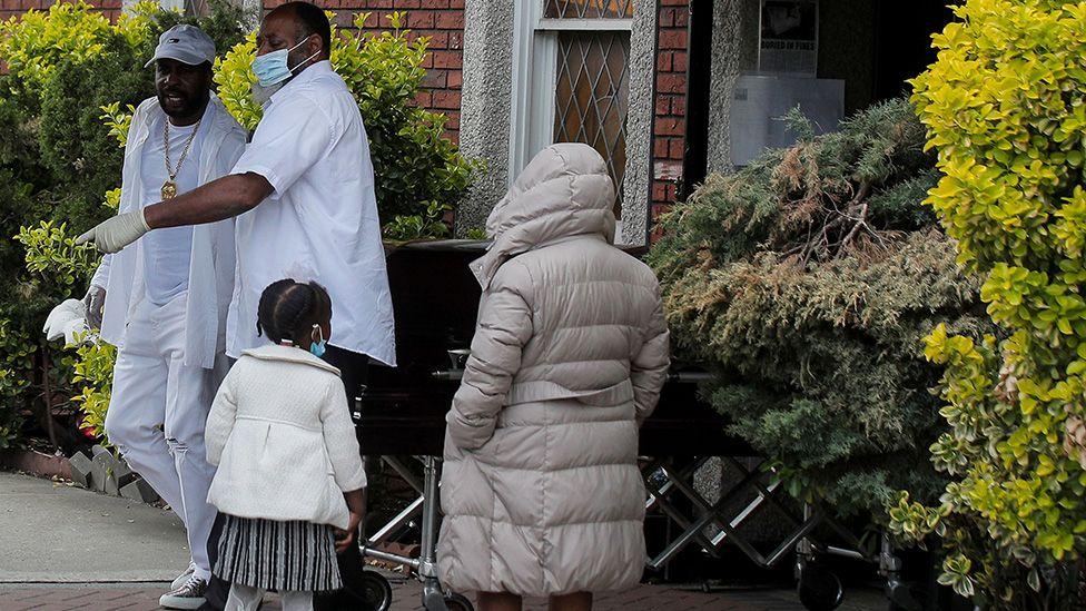 Pallbearer exit a funeral in Brooklyn