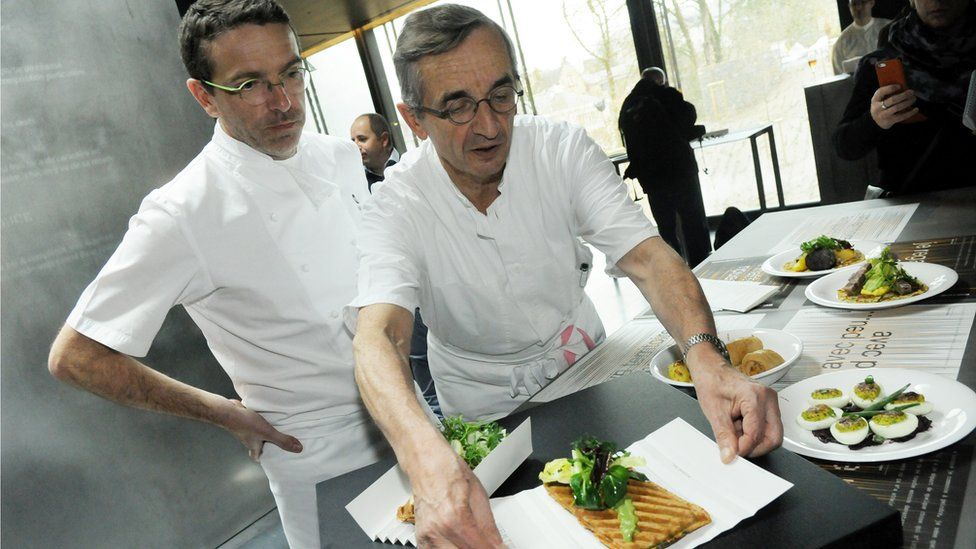 French chef Michel Bras and his son Sebastien present a dish at Bras' new restaurant in the Soulages museum in Rodez, southern France, on 25 March 2014