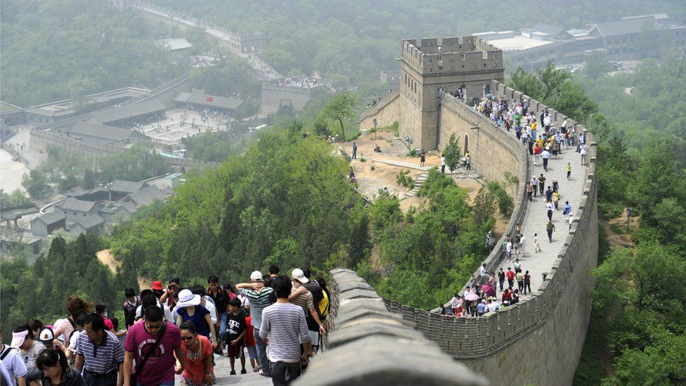 Tourists on a section of the Great Wall on the outskirts of Beijing
