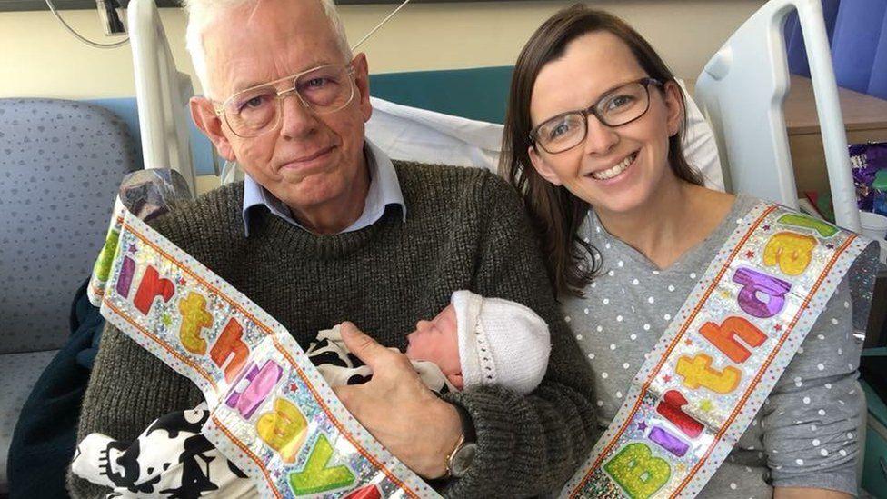 Philip Hutchinson, his grandson Logan, and his daughter, Catherine McLatchie