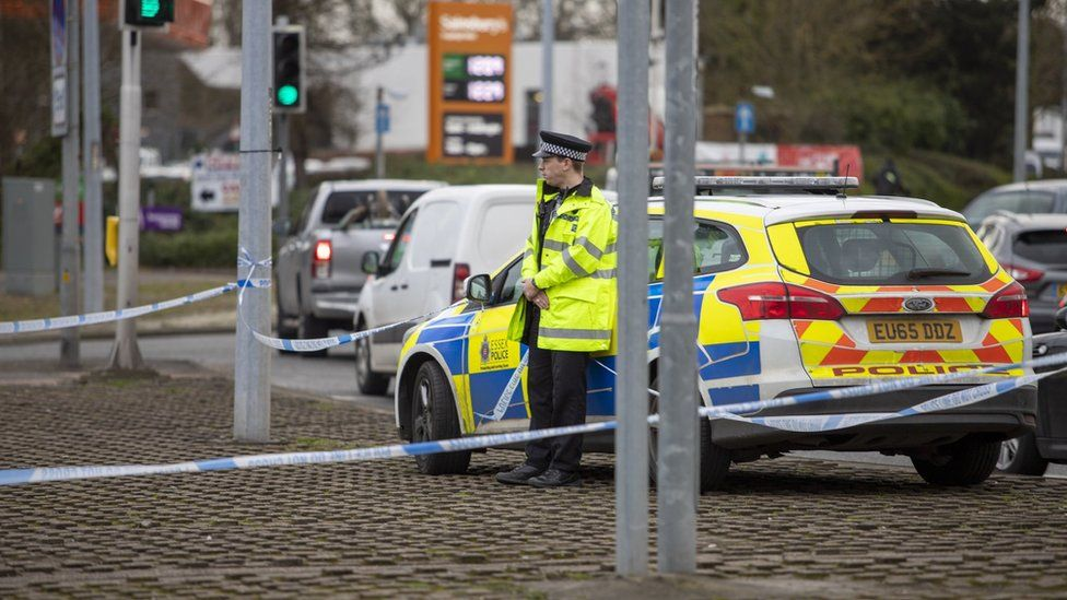 A police officer at the road closure at Rayleigh Weir