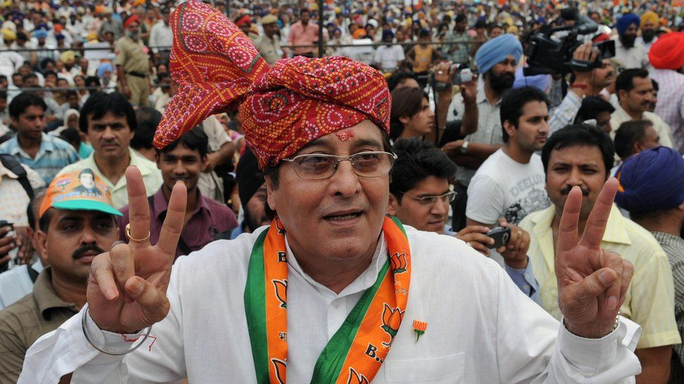 Opposition Bharatiya Janata Party (BJP) candidate for Gurdaspur and Indian film actor Vinod Khanna makes a victory sign during an election campaign rally on the outskirts of Gurdaspur on April 24, 2009.