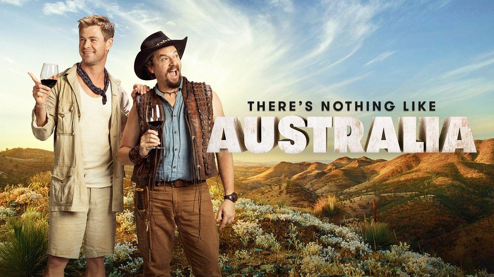 """Actors Chris Hemsworth and Danny McBride hold wine glasses in a Tourism Australia poster, which says: """"There's nothing like Australia."""""""