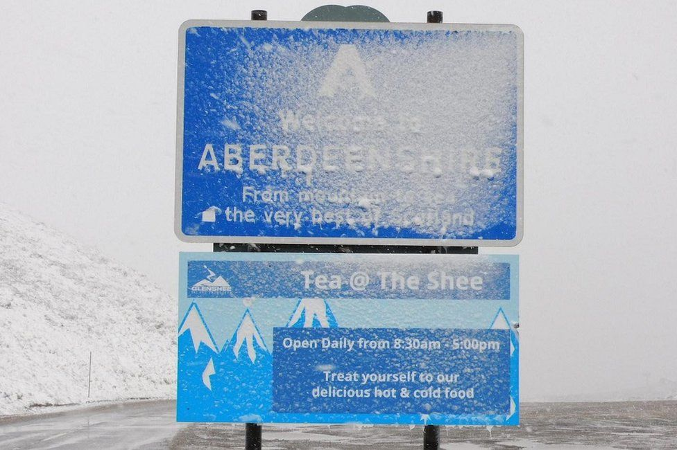 Snow covered road sign