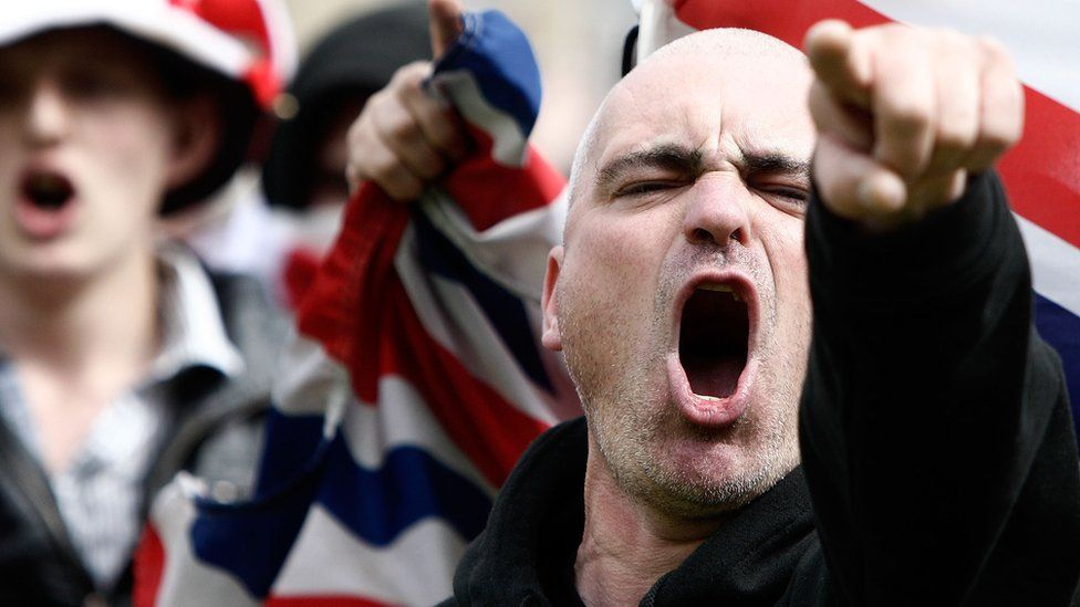 English Defence League supporters chant during a demonstration in the city centre on August 27, 2010 in Bradford, England.