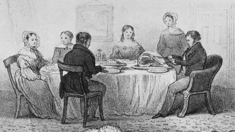 Middle class Victorian household at dinner