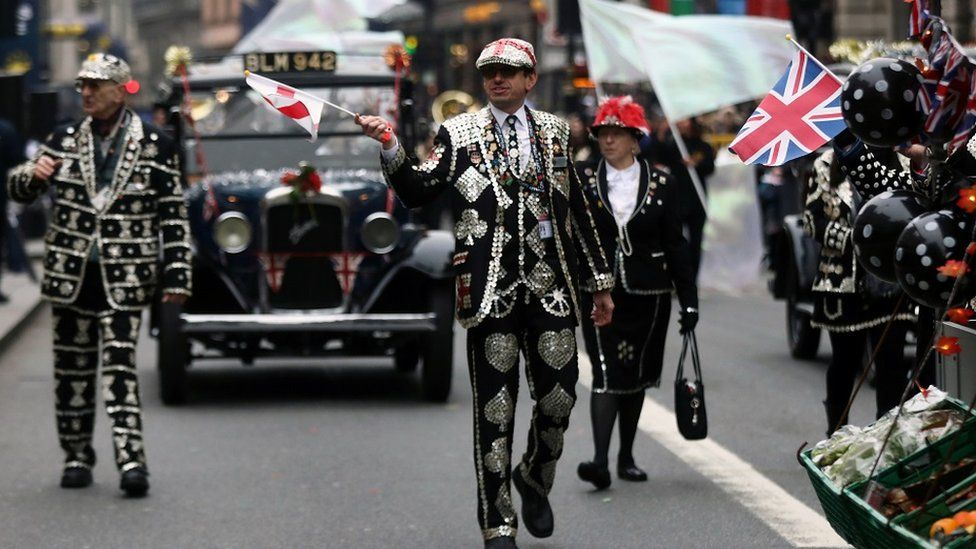 Members of Pearly Kings and Queens take part in the New Year's Day Parade in London