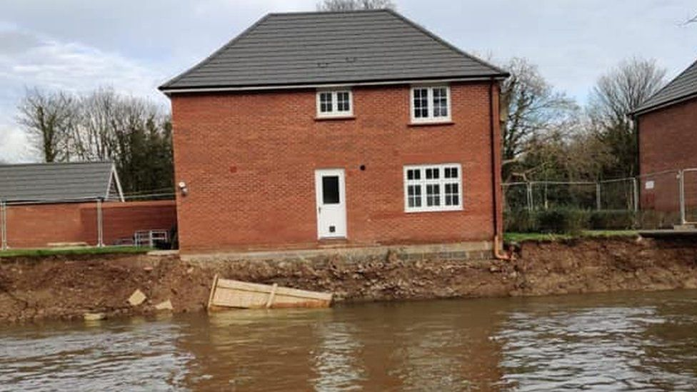 Damaged house by river