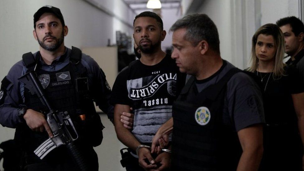 Rogerio Avelino da Silva, also known as Rogerio 157, who is accused by authorities to be the drug dealing chief of Rocinha slum, is escorted by policemen at a police station complex in Rio de Janeiro, Brazil December 6, 2017.