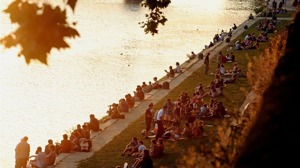 People relaxing along the river in Toulouse