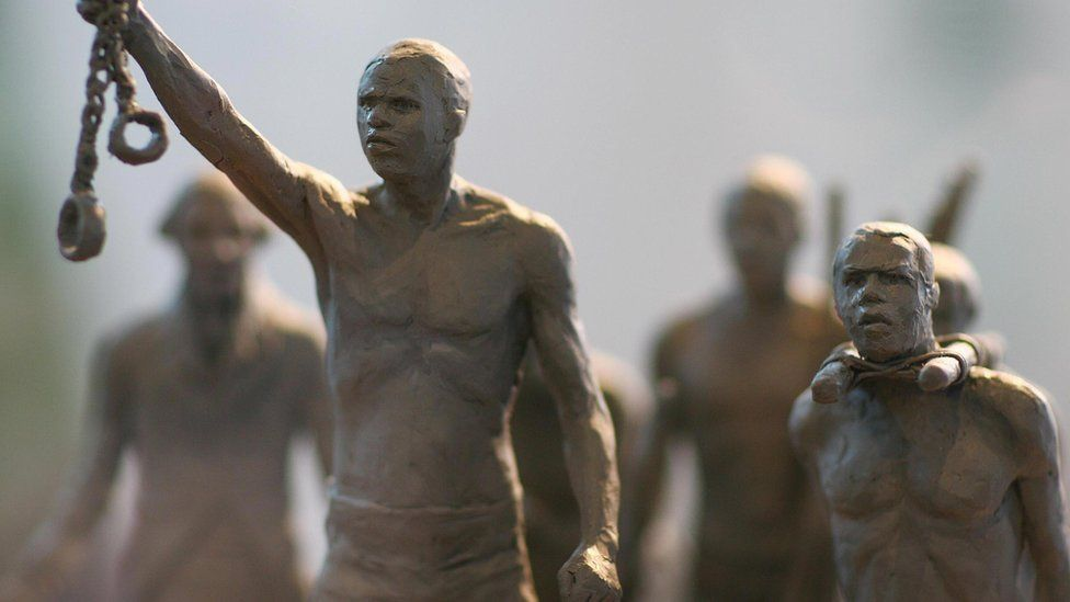 A maquette of a statue commemorating the enslaved Africans whose lives were lost during the slave trade is pictured as it is unveiled by Boris Johnson in central London, on August 18, 2008