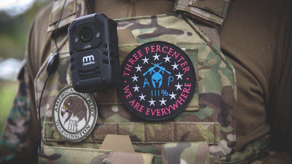 Three Percenter militia insignia