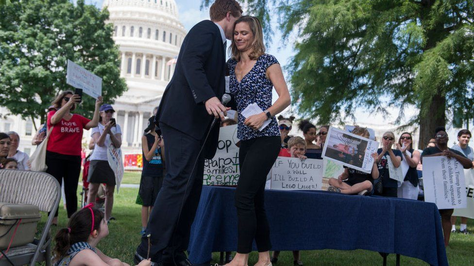 Maeve Kennedy McKean greets her cousin Joe Kennedy during a rally in DC to condemn the separation and detention of families at the border of the U.S. and Mexico on June 21, 2018