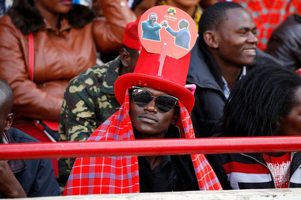 A man waits ahead of the inauguration ceremony for Uhuru Kenyatta at Kasarani Stadium in Nairobi, Kenya, 28 November