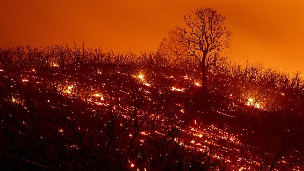 Embers smoulder along a hillside after the Ranch Fire, part of the Mendocino Complex Fire, in California, on August 5, 2018.