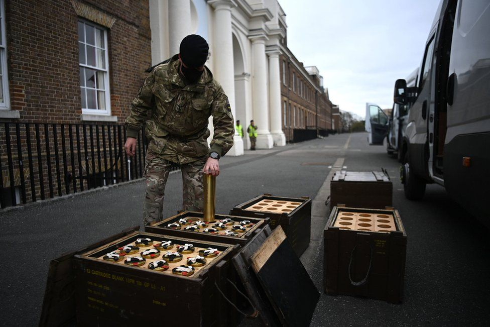 Members of the King's Troop Royal Horse Artillery place empty shells into boxes in advance of firing a 41-round gun salute at Woolwich Barracks in London.
