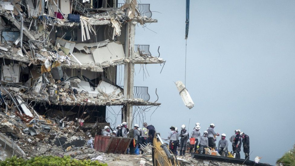Rescue team search the partially collapsed Champlain Towers South condominium building in Surfside, Florida,