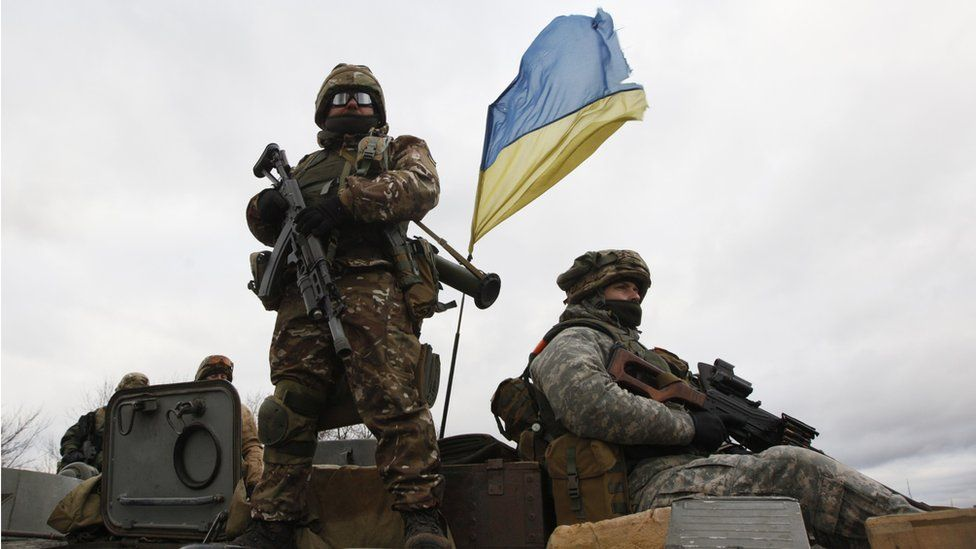 Ukrainian military personnel on an armoured personnel carrier, near Donetsk, December 2014