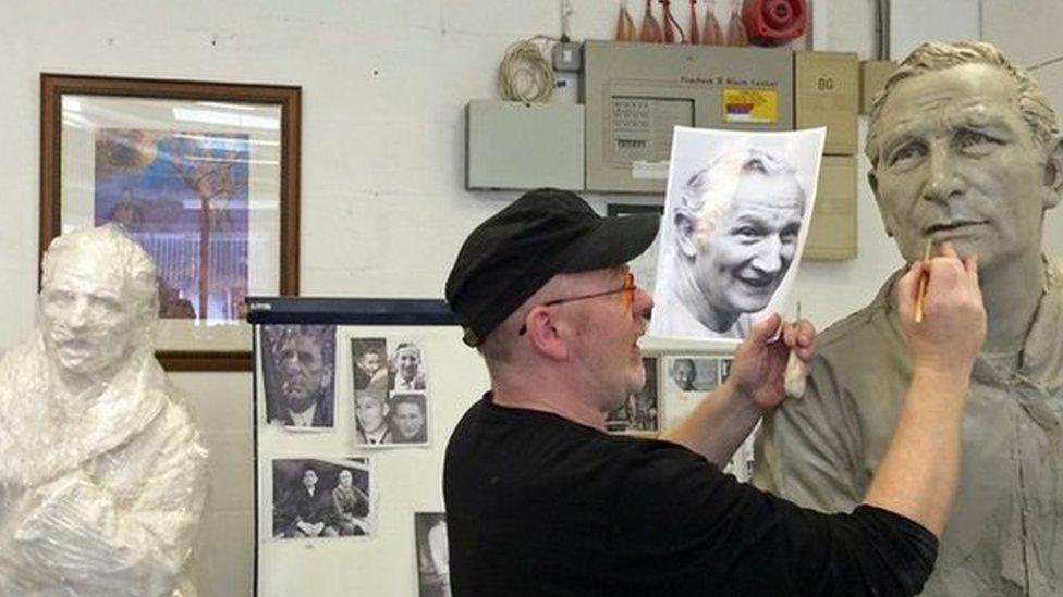Andrew Edwards works on Jack Wheeler's face
