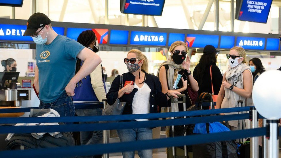 Air travellers check in for their flights in John F. Kennedy International Airport in New York City. File photo