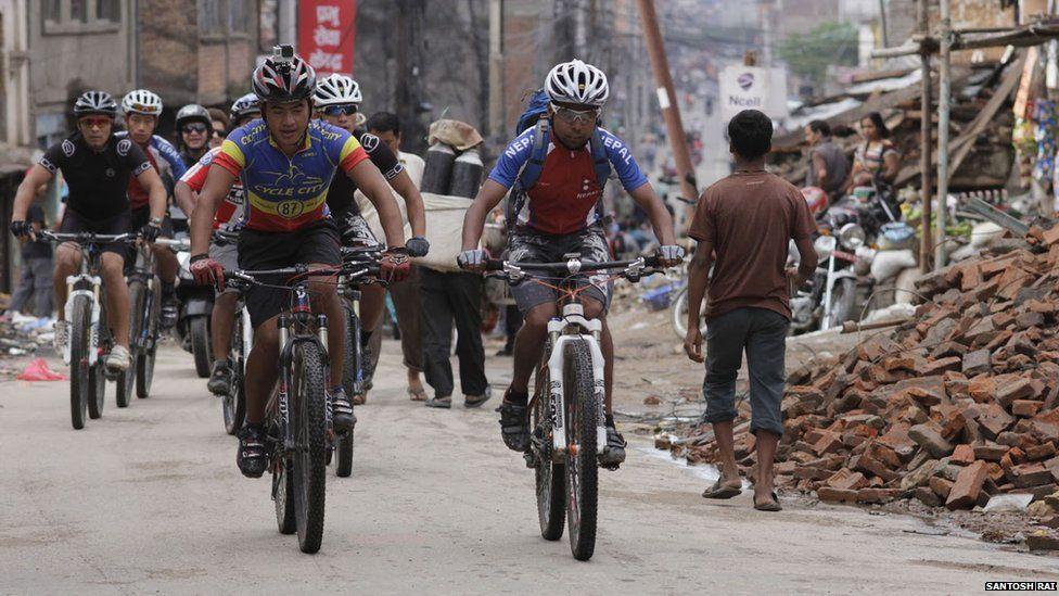 Nepali cyclists on the street