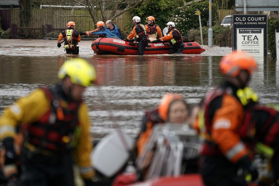 Firefighters rescue staff and residents from a care home in the village of Whitchurch.