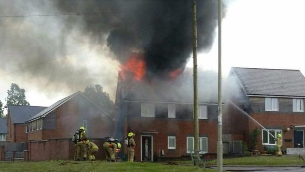 Hirwaun house fire showing flames coming from the roof