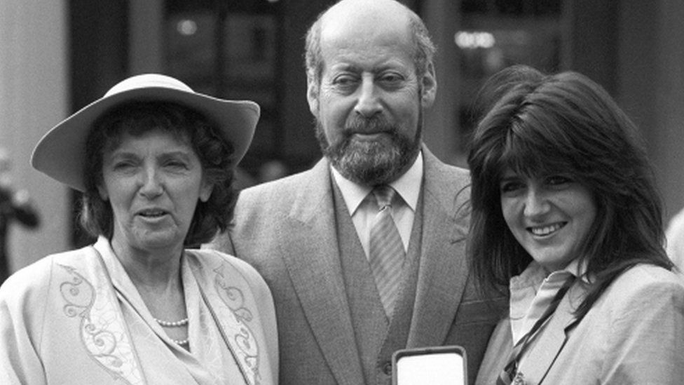 Sir Clement Freud with his wife Jill (left) and daughter Emma after receiving his knighthood in 1987